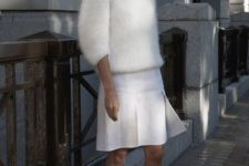07 a white anogra sweater with half sleeves, a white pleated skirt and grey heels for a modern look
