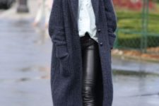 07 black leather pants, a white shirt, black boots and an extra long navy cardigan