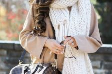 08 a creamy chunky knit scarf over a short camel coat for a stylish look