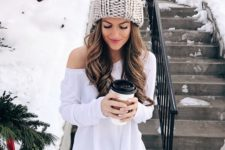 08 a cute light grey oversized beanie with a large pompom to make a statement