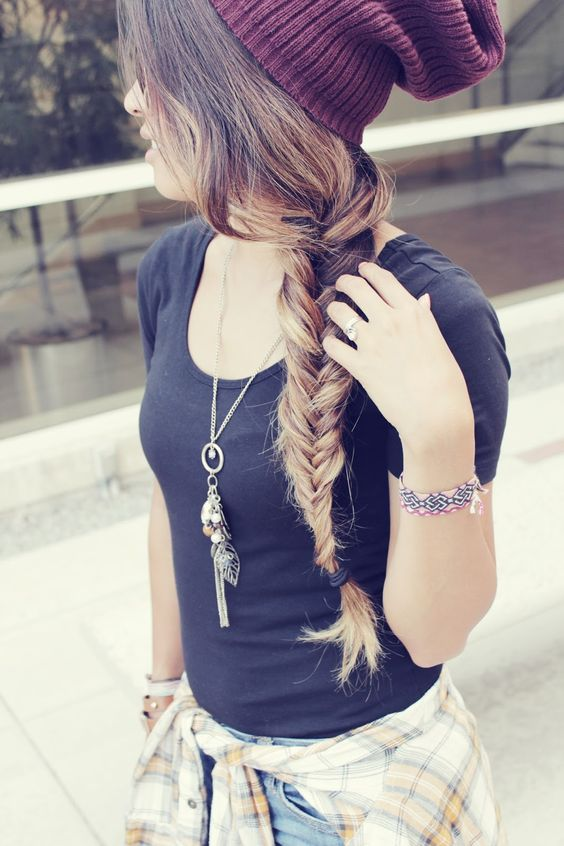 a fishtail braid under a beanie always looks cool and chic