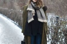 08 a layered look with a black sweater, a grey scarf, blue denim, an olive green coat and cognac chelsea boots