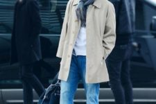 08 blue jeans, amber boots, a white tee, a neutral coat and a beanie