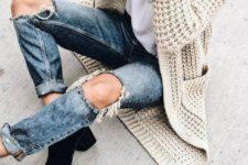 08 ripped denim, black suede booties and a neutral chunky knit cardigan