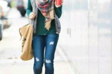 08 ripped jeans, an emerald turtleneck, a quilted vest, a plaid scarf and brown boots