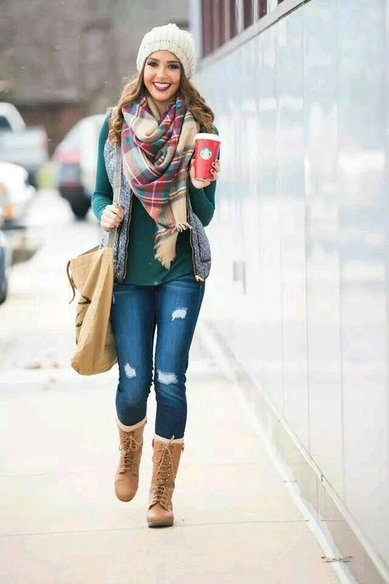 ripped jeans, an emerald turtleneck, a quilted vest, a plaid scarf and brown boots
