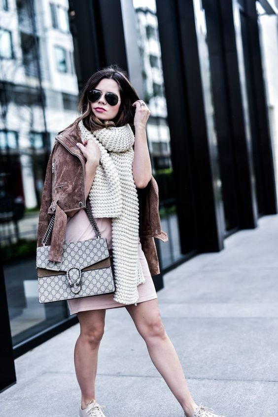 a blush dress, a brown suede jacket and a creamy chunky knit scarf