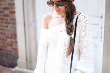 09 a large messy braid and a chunky knit beanie is a perfect match