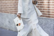09 a white maxi dress, a white jacket, white boots and a clutch