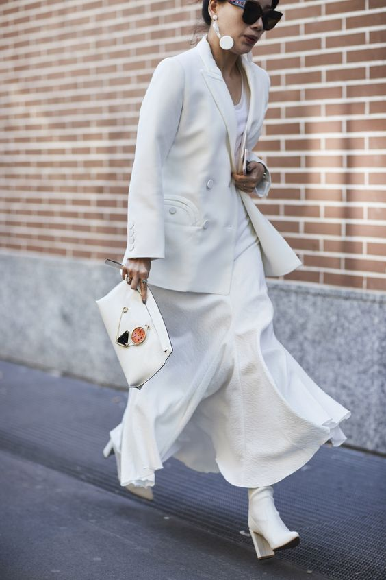 a white maxi dress, a white jacket, white boots and a clutch