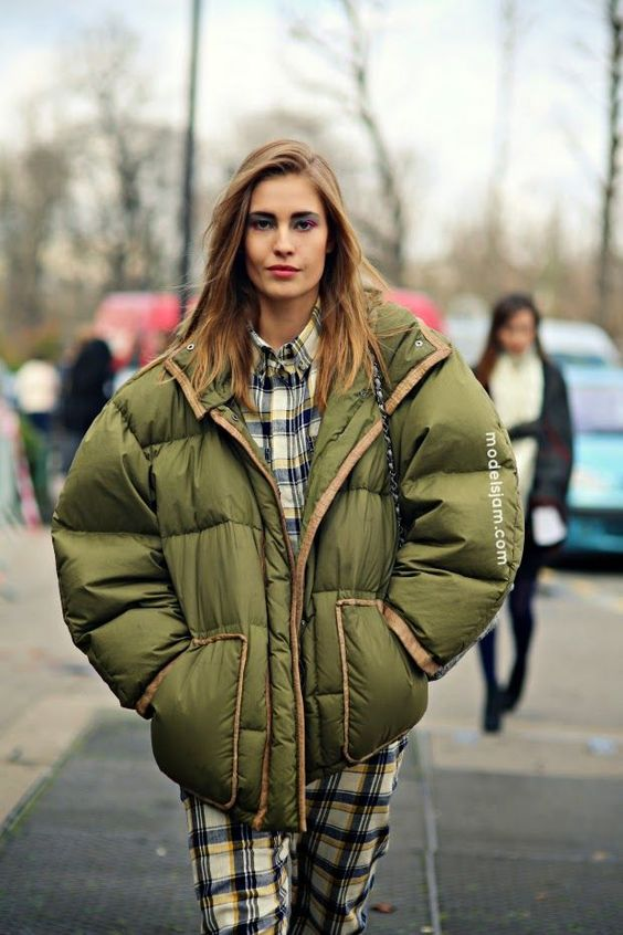 an oversized olive green puffer jacket for a chic look