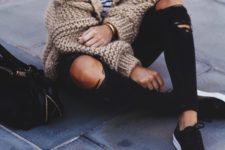 09 ripped black jeans, a striped top, black sneakers and a beige chunky knit cardigan