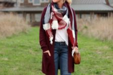 09 ripped jeans, a white top with long sleeves, a burgundy long cardigan and neutral booties