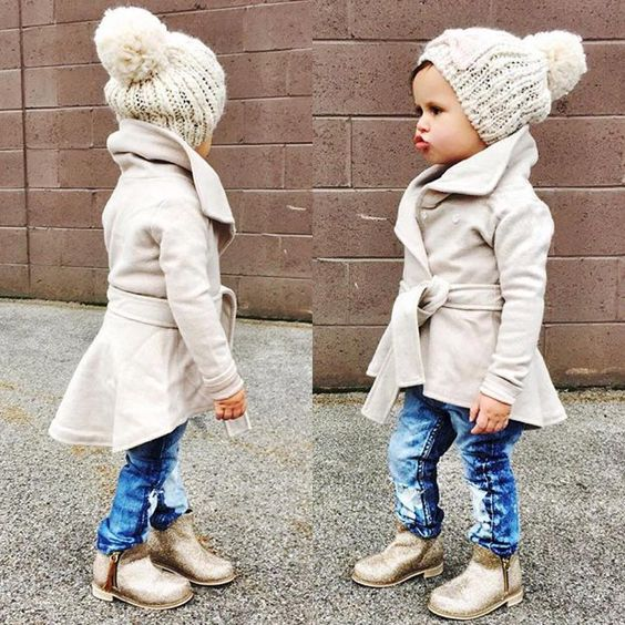 a gorgeous modern neutral coat, a matching beanie and distressed denim and boots