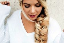 10 a large twisted fishtail braid and a neutral beanie look glam together