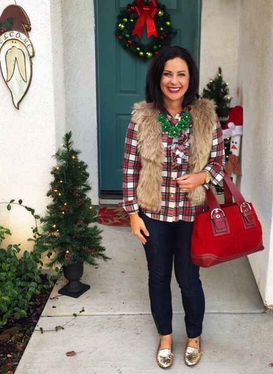 a plaid shirt, navy skinnies, a faux fur vest, glitter flats and a red bag