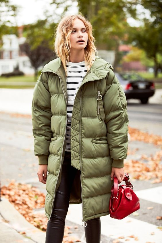 an olive green oversized puffer coat looks not so bold