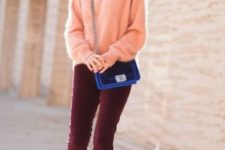 10 burgundy velvet pants and a peach-colored angora sweater, black heels and an electric blue bag