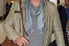 10 grey pants, a grey sweatshirt, a grey scarf and an olive green leather jacket