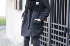 11 a black coat, a black scarf, grey jeans and light brown booties