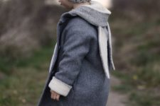 11 a grey coat with a small hood and bunny ears hanging – can there be anything cuter than that