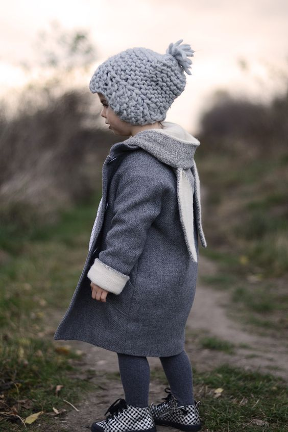 a grey coat with a small hood and bunny ears hanging - can there be anything cuter than that