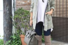 11 a neutral slouchy beanie matches the tall boots and keeps warm