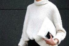 11 a white chunky knit sweater, black jeans and a white clutch