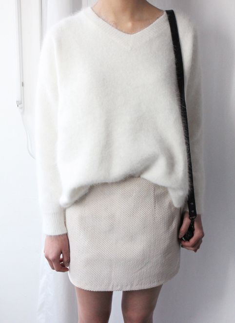 a white mini skirt and an oversized white angora sweater for a minimal chic outfit