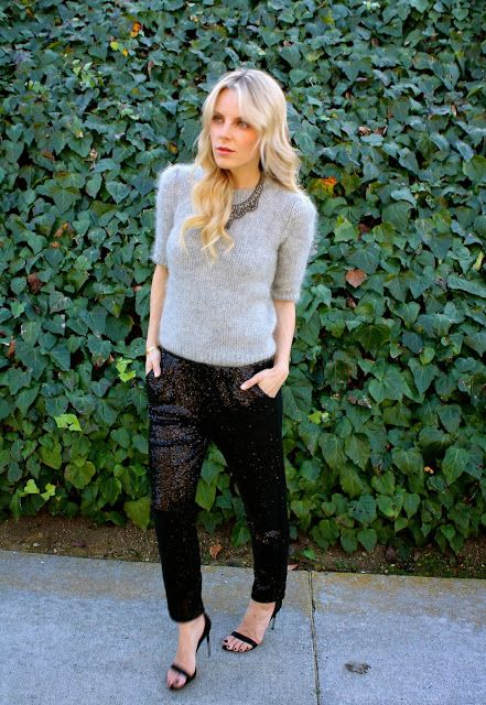 black sequin pants, black shoes and a grey angora sweater plus a statement necklace for a party