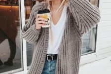 11 blue jeans, a white tee and a comfy neutral chunky knit cardigan