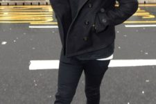 11 brown boots, a black sweater, black jeans, a black short coat and a beanie
