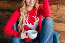 11 ripped denim, a red deer sweater, an emerald beanie