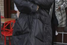 12 a black oversized puffer coat rocked by Rihanna