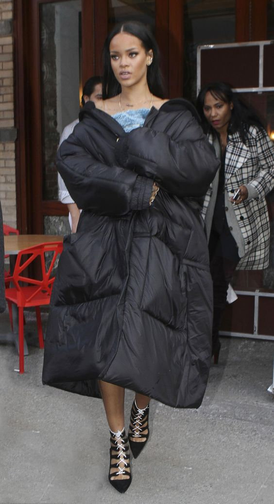 a black oversized puffer coat rocked by Rihanna