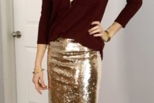 12 a burgundy sweater, a gold sequin pencil skirt and a gold statement necklace