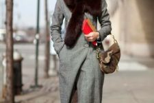 12 a grey winter coat with a large faux fur stole is sure to keep your warm