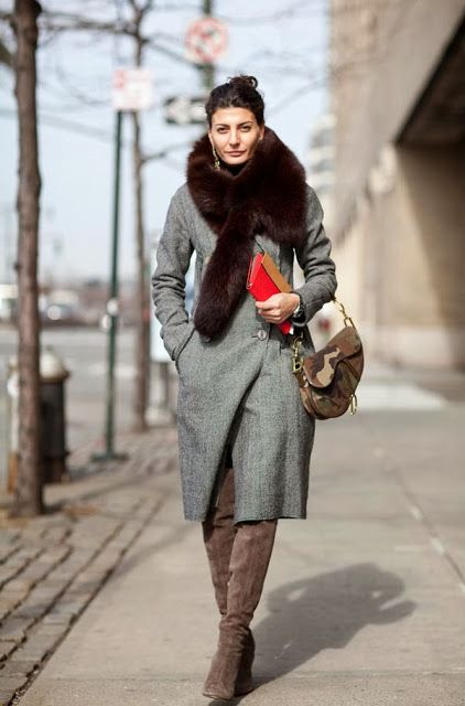 a grey winter coat with a large faux fur stole is sure to keep your warm
