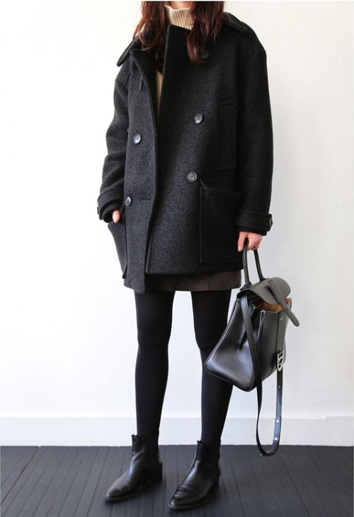 a short black coat with a straight silhouette, a backpack, black tights and black boots