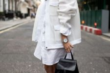 12 a white shirt dress, a white coat and black boots and a backpack for a contrast