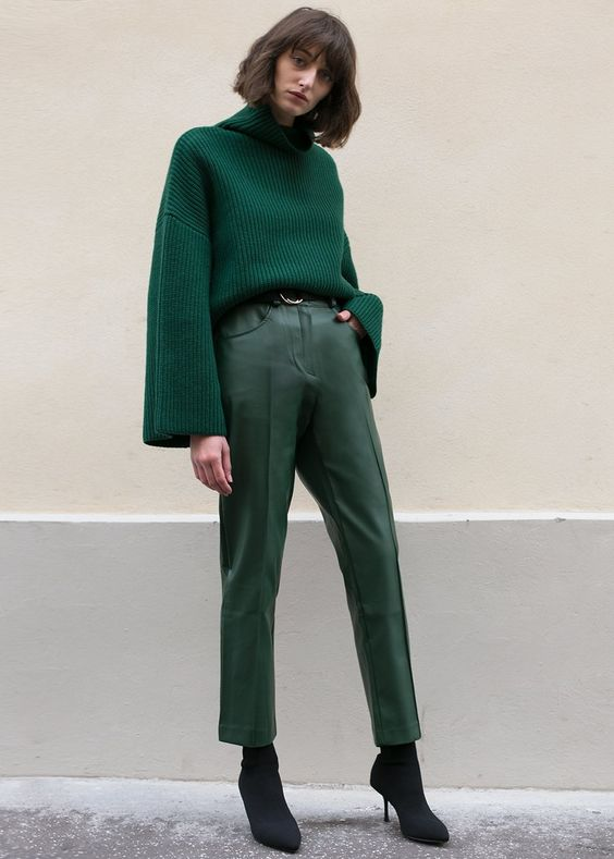 an emerald oversized sweater, green leather cropped pants and black sock booties