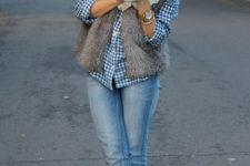 12 blue jeans, a plaid shirt, a faux fur vest, a creamy scarf and neutral booties