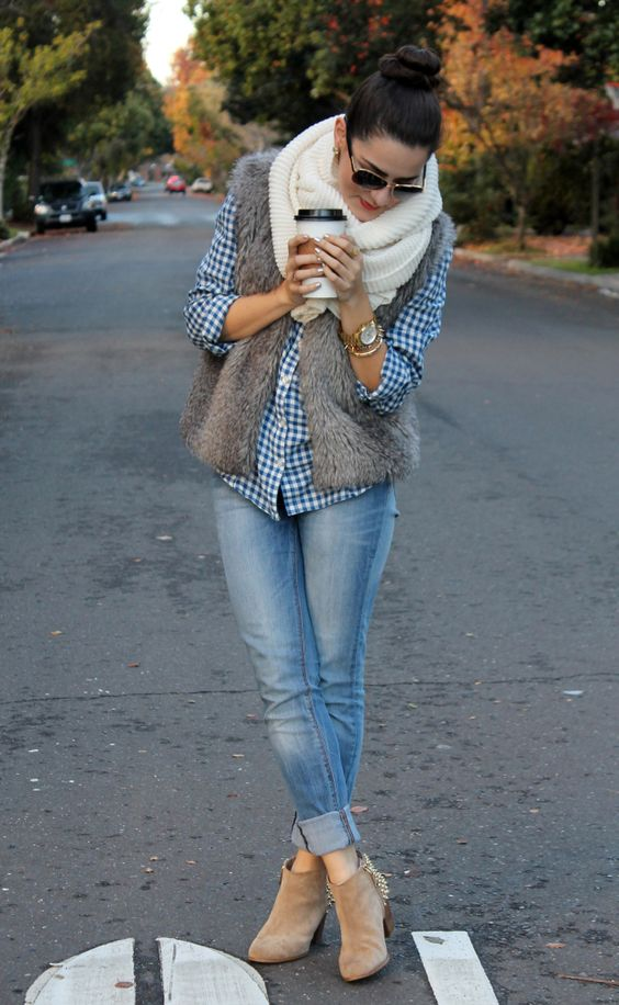 blue jeans, a plaid shirt, a faux fur vest, a creamy scarf and neutral booties