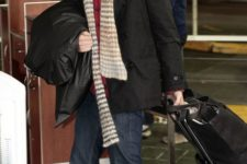 12 navy jeans, a red sweater, a scarf, a black coat and brown boots by Lee Pace