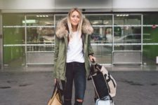 12 ripped jeans, a white tee, white sneakers, an olive green parka with faux fur