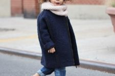13 a modern navy coat with a straight silhouette and a zip looks very adult-like