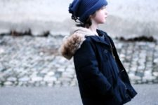 13 a navy parka with faux fur, denim and navy ugg boots