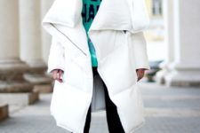 13 a white oversized puffer coat is a chic and very eye-catchy idea