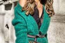 13 an emerald angora cardigan with a belt over a black lace top and a snake print clutch