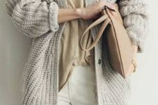 13 cozy layers with white jeans, a neutral tee and a grey chunky knit cardigan